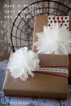Dress up a brown box with a wax paper bow-snowball-fluffy-thing: | 24 Cute And Incredibly Useful Gift Wrap DIYs
