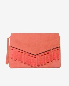 "Our latest clutch is one to have and to hold throughout the season. Crafted in sumptuous pink suede and finished with flirty tassels on the flap, this piece will add an extra pop of color to all your casual outfits.  Tassel clutch in gelato pink Removable wristlet strap Magnetic snap closure; one inside zip pocket Approx. 8"" H x 11 ½"" W x 1 ½"" D Suede/rayon Imported"
