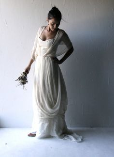 A longtime favorite of mine... this grecian inspired wedding dress is so soft and flowing, enveloping you in an intricate flow of airy chiffon.  The