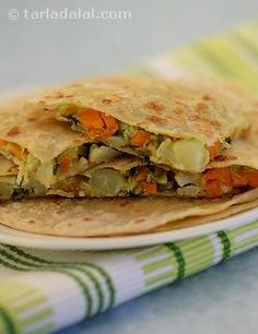 Kids love the oozy, cheesy feeling while eating this paratha that they forget that they're munching on veggies at the same time. Use mozzarella cheese for that extra oozy, gooey texture. Say cheese!