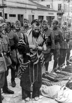 One of the most famous images of the holocaust is of Rabbi Moshe Hagerman the Dayan - Jewish municipal chief judge, dressed in his Talit and Teffilin and being abused by German soldiers. This image was later identified by people who survived the war and the incident, as an image from the 'Bloody Wednesday of Olkusz', taken on July 31, 1940