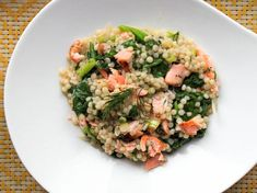 Warm Couscous Salad With Salmon and Mustard-Dill Dressing - Flakes of salmon and wilted spinach add body and flavor to this warm couscous salad that's seasoned with mustard and dill. Ready in under 30 minutes, it's perfect for a quick weeknight meal or picnic lunch.