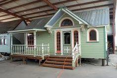 tiny house ~ really like the porch idea on this