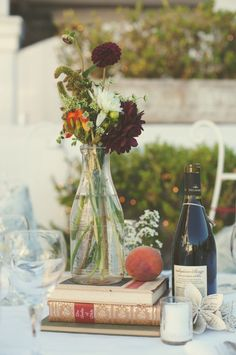 Centerpiece - could change wine bottle to baby bottle & use children's books for baby shower!