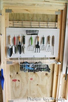 Some pegboard and a basket make great use of the inside of door space in a shed