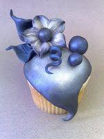 Whimsical Midnight Bloom Cupcake