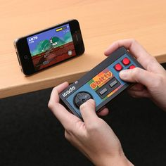 Retro Wireless Game Controller - The iCade 8-Bitty controller works perfectly with your iPhone, iPad and Android devices. I want one!!