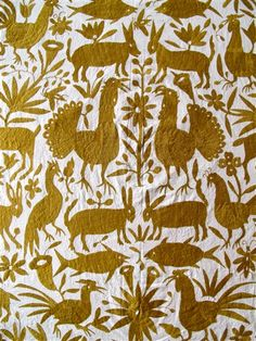 """Tenango (hand-embroidered blanket) handmade by the Otomi Indians of Hidalgo, Mexico — """"It is said the designs have been inspired from the ancient cliff paintings in the region."""" I find that the asymmetry, despite general mirroring, gives life to the otherwise stationary animals."""