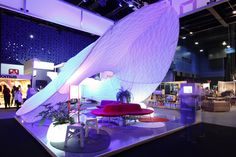 Organic Fabric Structure at Expo Habitat 2014, designed by Victoria Montoya, fabricated by Fabric Images Internacional.  This tradeshow display incorporates internal lighting for a soft glow behind the dye sublimation printed graphics; Fabric architecture; Lightweight display.