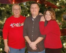 Here is an example of a family portrait using the green screen and a custom Christmas background.