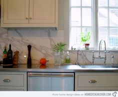 This backsplash is made of Calcatta marble wherein the patterning is predominately larger and thick than the Carrara marble. This one is unique because it was made in one chunk rather than in tiles which is more common on backsplashes.