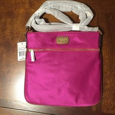 "NWT Michael Kors Jet Set Flat Nylon Crossbody NWT Michael Kors Jet Set nylon flat crossbody in fuschia. So cute! Lays flat against your body. Strap is ""luggage"" color saffiano leather, and adjustable with a buckle. Lots of room despite its flat appearance. Michael Kors Bags Crossbody Bags"