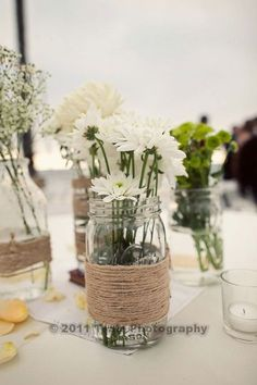 I collected old vintage mason jars and bottles for a year! Wrapped them with twine= super easy and cheap centerpieces!
