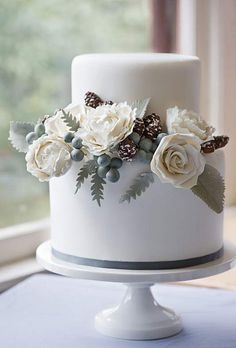 Winter Wedding Cake with Pinecones and Berries - so pretty! To go with my colour scheme, I would have the flowers in red.