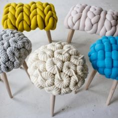 um, i think these are stools.  i need to learn how to do that big knit (is it just hand-done???) so I can make me a sweater!