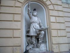 The statue of Väinämöinen (1888) by Robert Stigell (1852–1907) decorating the Vanha Ylioppilastalo (Old Studenthouse) built in Helsinki, Finland. The legendary storyteller holds his kantele, made out of a giant pike's jawbone.