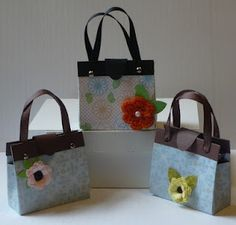 Helen makes a really cute treat-holder purse with instructions on her blog and a link to a YouTube video.  Great!