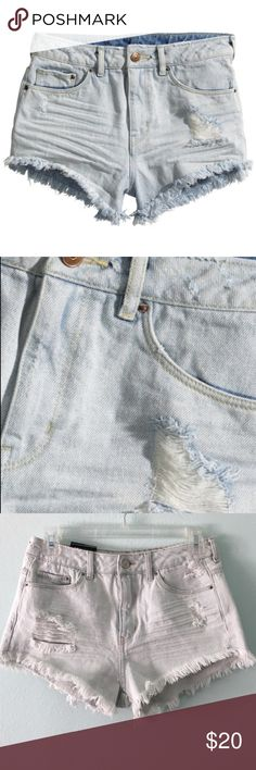 """H&M • NWT light wash distressed cutoff shorts NWT very light wash denim cut off cheeky shorts. (Color most like top pic. Pictures washed them out a bit.) Distressed. Size 6 (Divided by H&M.) Waist 13"""" across (best fits size 25/26.) Rise 10.5"""", hips 16"""" across. Inside of the shorts is the same color as the outside. Sold out online. H&M Shorts Jean Shorts"""