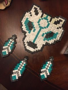 Wolf perler with matching feathers by SinCityKandiez on Etsy