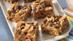 These chocolaty no-bake bars are filled with peanut flavor.