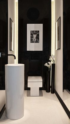 black and white | modern toiletroom inspiration byCOCOON.com | modern bathroom taps | solid surface washbasins and washbowls | bathroom design and renovation | COCOON Dutch Designer Brand More