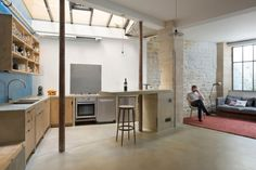 Loft : Retro Style Interior of Loft in Paris by Maxime Jansens - Retro Loft in Paris Interior Idea Designed by Maxime Jansens showing Open Floor Kitchen and Living Room and Decorated with Exposed Natural Brick and Stone Wall medium version