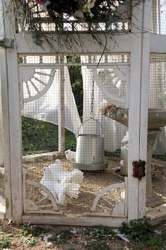 TatiTati Style - Beautiful white doves in this wonderful dove house made of antique sreen doors..  Good luck finding the doors