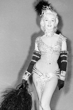"""Marilyn Monroe in an unused costume for Gentlemen Prefer Blondes (1953) This jeweled belt and feather fan are part of the original William Travilla designed costume Marilyn was to have worn during the """"Diamonds Are A Girl's Best Friend"""" number from """"Gentlemen Prefer Blondes."""" The publicity surrounding the recent discovery that Marilyn was the nude model in the """"Velvet Dreams"""" calendar photo rendered this particular costume too revealing. The pink gown worn in the film, also designed by ..."""