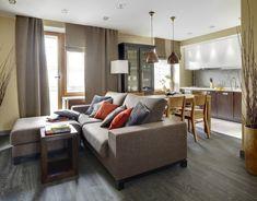 kleines-wohnzimmer-essecke-braunes-polstersofa-holz-esszimmermoebel-kuechenzeile