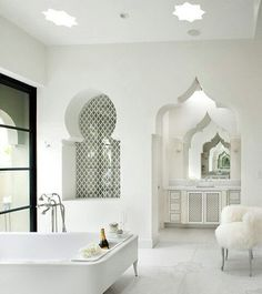 Moroccan Luxury Bathroom Design With Traditional Shape Windows And Door Entrance White Modern Bathtub White Fur Elegant Chair Unique Marble Shape