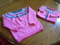 This pattern is written for babies from 3 month sized through children size 8. The sweater can be made either as a pullover or a cardigan, and in colors suitable for a boy or a girl, making it is a very versatile pattern. Because the yoke is made with variegated yarn it gives the look of Fair Isle without all the work. The top down one piece construction makes this pattern the perfect pattern for a knitter with little to no sweater experience.