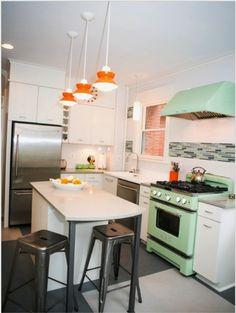 Love that jadeite color stove and orange hanging pendants #mintgreen