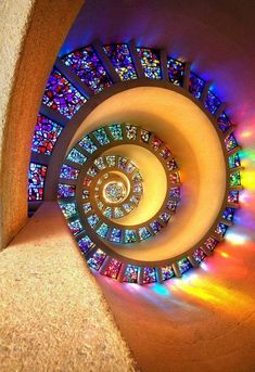 NOT STAIRS - Glory window - Chapel of Thanksgiving, Dallas, Texas, USA - A spiral stained glass window on the ceiling.