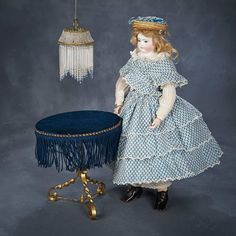 """French Bisque Poupee """"Aimee"""" by Adelaide Huret, Original Body, Trunk and Trousseau 18,000/25,000"""