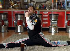 Tony Stewart stretching (and dipping his cookie in soda) for Mobil 1.