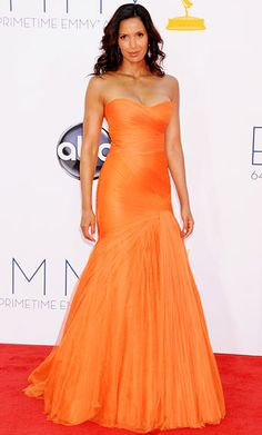 Top Chef host Padma Lakshmi rocked a strapless, orange Monique Lhuillier trumpet-style gown. Simple drop earrings and soft waves finished the look.