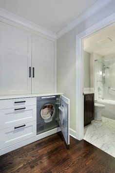 Hidden Washer and Dryer - Transitional - laundry room - 2 Design Group