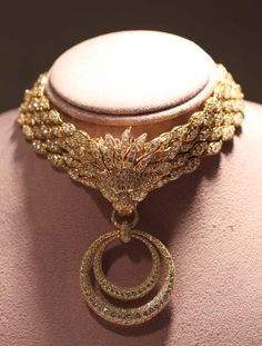 "Elizabeth Taylor's ""Granny"" Necklacewas from by Van Cleef & Arpels. She was a child bride at 18 (short-lived marriage No. 1 to Nicky Hilton) and a grandmother at the age of 38. Burton saw fit to honor the occasion with this gold-and-diamond set, which made Elizabeth's heart start ""clicking like a castanet."" NOTE: Elizabeth Taylor Granny Suite or Barquerolles choker by Van Cleef & Arpels. Sold for $902,500."