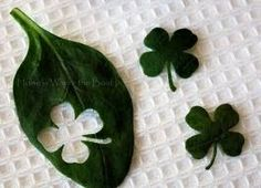 Shamrocks made from spinach leaves.  Use as garnish for salads, deviled egg topper, etc.  From: http://stepford-sisters.blogspot.com/2013/03/st-patricks-day-menu.html
