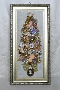 A Christmas tree made from vintage jewelry.