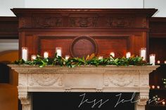 willowdale estate : winter wedding : garland on mantle with pillar candles : les fleurs
