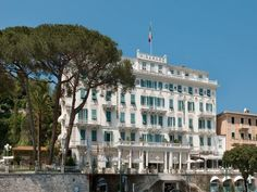 The Art Nouveau building gleams white in the sun amid century-old gardens. But for all of the grandeur, what most seduces are the intimate and almost down-home touches. Owner Andrea Fustinoni affectionately calls the hotel the Mira, which speaks to the feeling of being welcomed into a private residence. Each of the 36 deluxe rooms has a sea view, while the 26 superior rooms all have balconies or patios overlooking the hotel's gardens as they rise toward the foothills of Mount Portofino. Santa Margherita Ligure, Hotel Eden, Luxury Collection Hotels, Beste Hotels, Destinations, French Colonial, Destination Voyage, Grand Hotel, Hotel Reviews