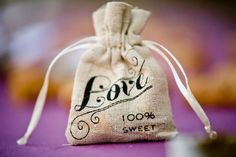 Wedding favors in burlap bags.