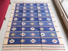 'Blåklint' MMF AB Kilim #foundbyhowe Swedish 1944. Blåklint is Swedish for 'cornflower'.  The designer of this carpet Marianne Richter specialised in creating patterns that had deep roots in Nordic folk arts & were rich in imagination. She played a significant role in the MMF AB workshop & was one of two students that worked closely with Barbaro Nilsson. Nilsson became the artistic director of the MMF workshop on the death of Märta Måås-Fjetterström in 1941 following the rescue campaign to…
