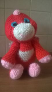 Introducing Red the baby dragon!  When I asked my little niece in what colors she would like her dragon to be in she told me red and pink. I was a bit worried about this color combo but the bright ...