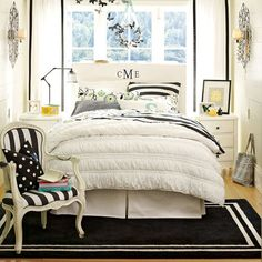 Black & White bedroom with yellow accents  Love the butterflies fleeing the wreath
