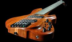 awesome guitars   found music: Little Guitar Works makes really twisted Bass Guitars