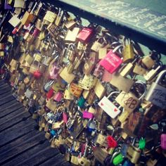 Paris bridge of locks.  ~people in love take a pad lock write their names on it and lock it onto the bridge. Then you through the key off the bridge And into the river so your lock can never be unlocked. Symbolizing that you will be connected forever.