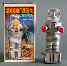 About 5 inches tall and made in Japan by Masudaya – Modern Toys – in 1985. An old stock robot which lumbers forward when wound.