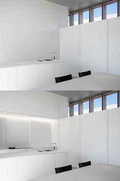 Hidden kitchen by Belgian architects Minus.